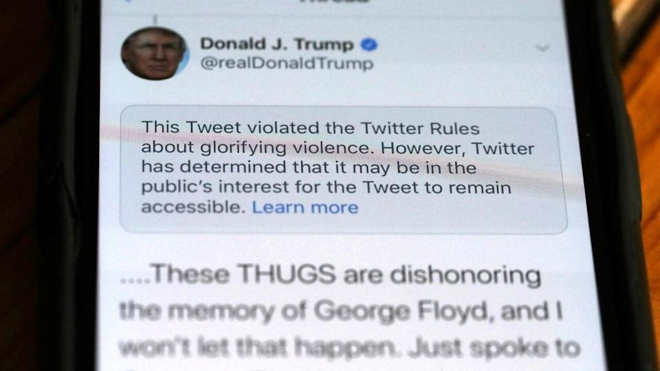 In this photo illustration a notification from Twitter appears on tweet by U.S. President Donald Trump that the social media platform says violated its policy on May 29, 2020 in San Anselmo, California. Twitter has started to flag some of President Trump's tweets that violate the company's terms. (Photo by Justin Sullivan/Getty Images)