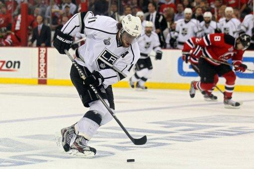 Los Angeles Kings' Anze Kopitar skate the puck up the ice before scoring the game-winning goal during overtime on May 30. The Kings downed the Devils 2-1 in the opening game of the NHL championship Stanley Cup Finals