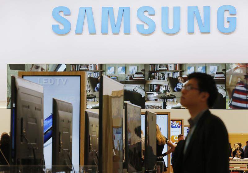 A journalists walks at the Samsung booth during a media preview day at the IFA consumer electronics fair in Berlin