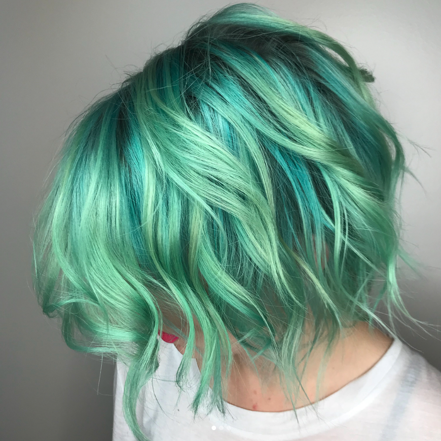 """<p>Another alternative to cotton candy-esque blues and greens is sea glass, which is perfect for those who want a bold but multidimensional blue shade. <a href=""""http://www.more.com/beauty/hair/hair-color/sea-glass-hair-cutting-front-dye-trends"""" rel=""""nofollow noopener"""" target=""""_blank"""" data-ylk=""""slk:More.com"""" class=""""link rapid-noclick-resp"""">More.com</a> reports that this breathtaking hue was created by a color company called Pulp Riot, which aims to re-create the gorgeous tones found in actual sea glass or discarded jewelry on the ocean floor.<br>To create the look, McGowan Hansen recommends combining different highlights of blue and green throughout the hair, making it best suited for blondes or those with prelightened hair.<br>""""Sea glass is similar to the soft candy pastel look, but it offers a more sheer finish,"""" she says. """"Create the look by using ribbon highlights throughout blond hair to give it a slight hue of sea glass, which lightly accentuates the style."""" (Photo: Instagram/saraihairwizard) </p>"""