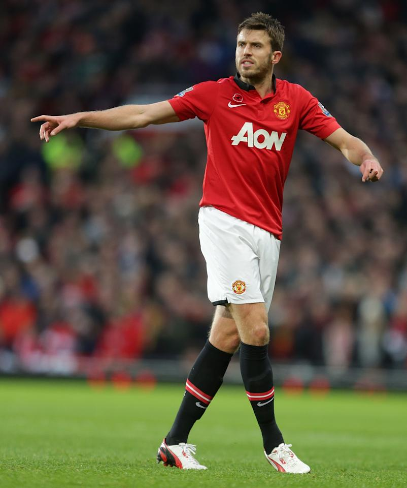 MANCHESTER, ENGLAND - NOVEMBER 10:  Michael Carrick of Manchester United in action during the Barclays Premier League Match between Manchester United and Arsenal at Old Trafford on November 10, 2013 in Manchester, England.  (Photo by Tom Purslow/Man Utd via Getty Images)