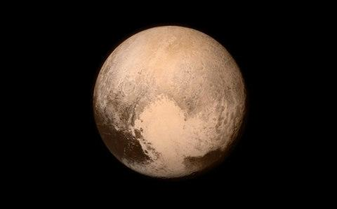 The first close up image of Pluto, taken by New Horizons - Credit: Nasa