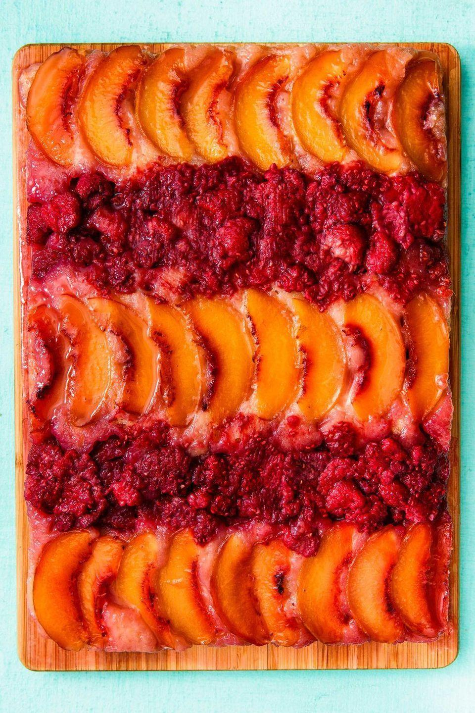 """<p>This cake is DANGEROUSLY good. Not to mention, it's a work of art!</p><p>Get the <a href=""""https://www.delish.com/uk/cooking/recipes/a32943108/raspberry-peach-upside-down-cake-recipe/"""" rel=""""nofollow noopener"""" target=""""_blank"""" data-ylk=""""slk:Raspberry Peach Upside-Down Cake"""" class=""""link rapid-noclick-resp"""">Raspberry Peach Upside-Down Cake</a> recipe.</p>"""