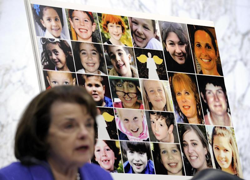 FILE – In this Feb. 27, 2013, file photo faces of Sandy Hook Elementary School victims are seen behind Sen. Dianne Feinstein, D– Calif., as she speaks about the Assault Weapons Ban of 2013 during the Senate Judiciary Committee on Capitol Hill in Washington. Congress returns Monday, April 8, 2013, from a two-week spring recess with gun control and immigration high on the Senate's agenda. Senators could start debating Democratic-written gun legislation before week's end. But leaders also might decide to give negotiators more time to seek a deal on expanding background checks for firearms buyers.  (AP Photo/Susan Walsh)