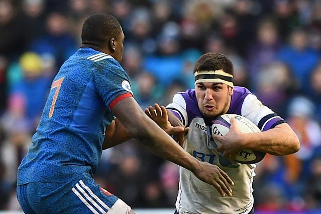 Scotland's hooker Stuart McInally is tackled by France's flanker Yacouba Camara during their Six Nations rugby union match, in Edinburgh, in February 2018 (AFP Photo/ANDY BUCHANAN )