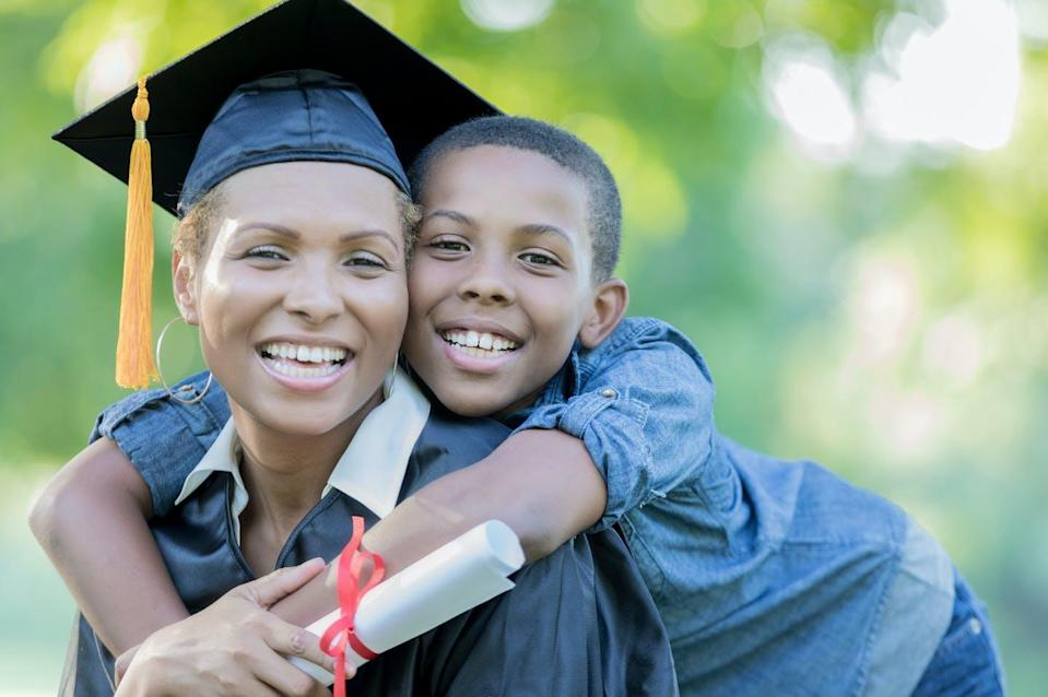 """<span class=""""caption"""">A stable residence on campus can help college students who are parents complete their degrees.</span> <span class=""""attribution""""><a class=""""link rapid-noclick-resp"""" href=""""https://www.gettyimages.com/detail/photo/tween-son-poses-with-mom-after-her-college-royalty-free-image/859125794?adppopup=true"""" rel=""""nofollow noopener"""" target=""""_blank"""" data-ylk=""""slk:SDI Productions/Getty Images"""">SDI Productions/Getty Images</a></span>"""