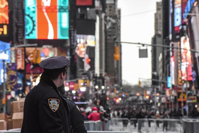 <p>Members of the New York City police department patrol in Times Square ahead of the New Year's Eve celebration on December 31, 2017 in New York City. (Photo: Stephanie Keith/Getty Images) </p>