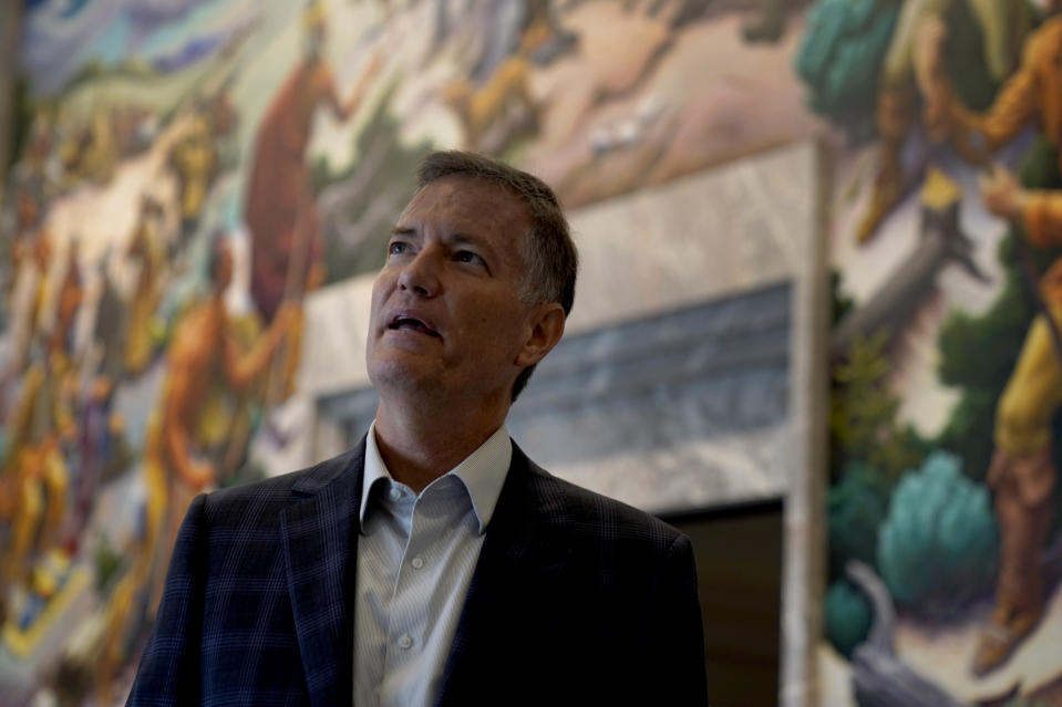 Museum director Kurt Graham leads a tour of the Harry S. Truman Presidential Library and Museum Wednesday, June 9, 2021, in Independence, Mo. The facility will reopen July 2 after a nearly $30 million renovation project. (AP Photo/Charlie Riedel)