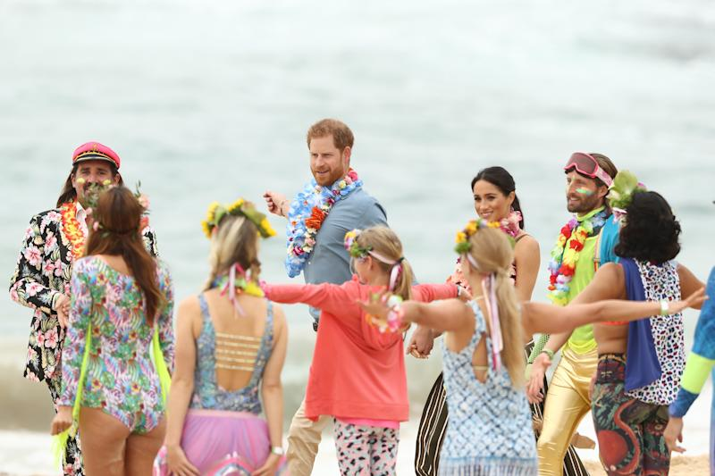 Prince Harry and Meghan Markle performed yoga stretches with OneWave members, a local surfing community group raising awareness for mental health and wellbeing, while in Australia in 2018.