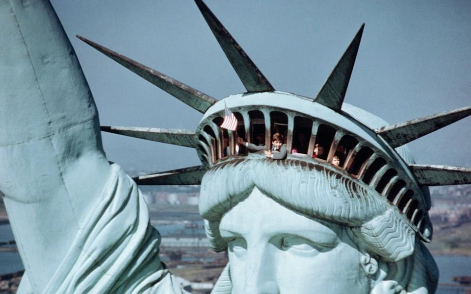 Visitors are still able to go inside the Statue of Liberty's crown – though the torch remains off limits - Bettmann
