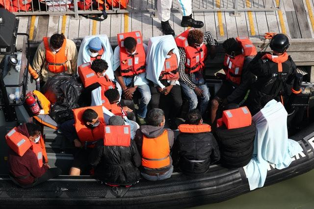 A group of people, thought to be migrants, waiting on a Border Force rib to come ashore at Dover marina in Kent (Gareth Fuller/PA)