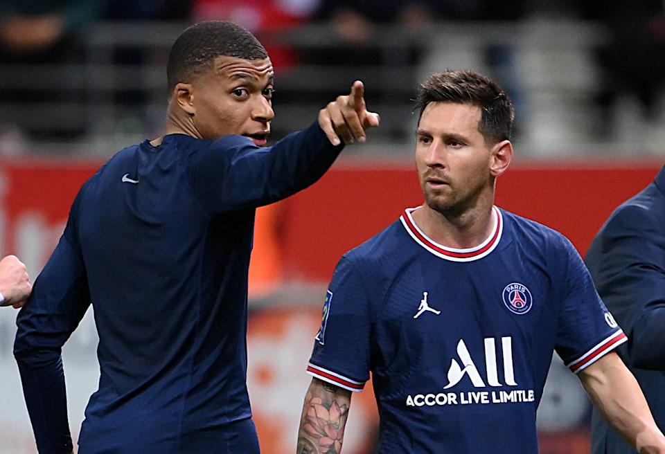 TOPSHOT - Paris Saint-Germain's French forward Kylian Mbappe talks to Paris Saint-Germain's Argentinian forward Lionel Messi at the end of the French L1 football match between Stade de Reims and Paris Saint-Germain at Auguste Delaune Stadium in Reims on August 29, 2021. (Photo by FRANCK FIFE / AFP) (Photo by FRANCK FIFE/AFP via Getty Images)