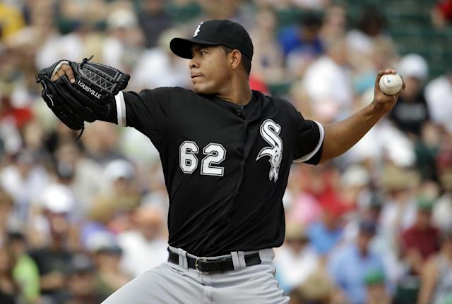 Chicago White Sox's Jose Quintana throws before an exhibition spring baseball game against the Los Angeles Angels, Thursday, March 13, 2014, in Tempe, Ariz. (AP Photo/Morry Gash)