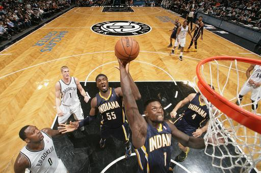 NEW YORK, NY - DECEMBER 23: Lance Stephenson #1 of the Indiana Pacers goes up to dunk during a game against the Brooklyn Nets at the Barclays Center on December 23, 2013 in the Brooklyn borough of New York City. (Photo by Nathaniel S. Butler/NBAE via Getty Images)