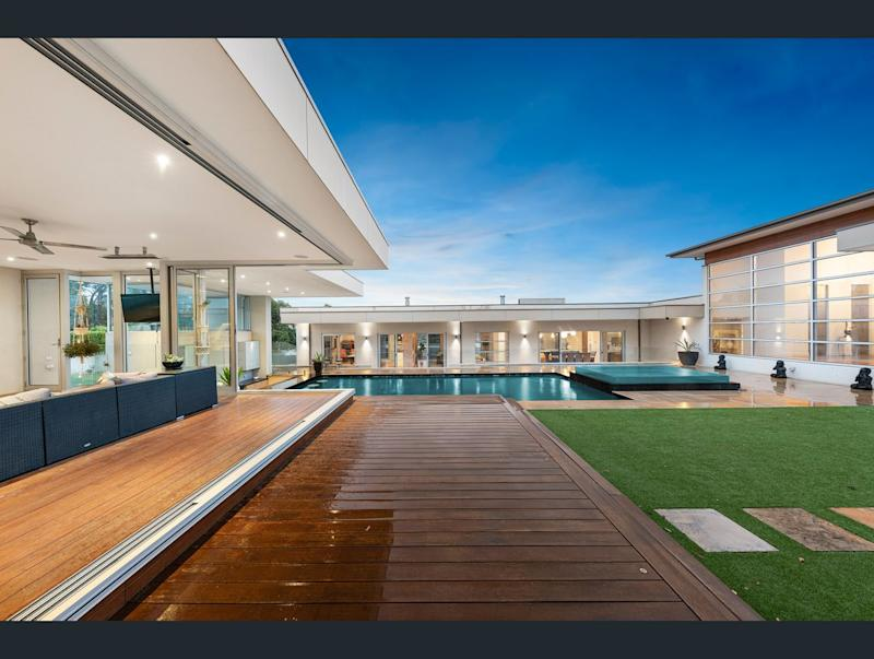 The home has an outdoor entertaining space in its centre. Image: Ray White