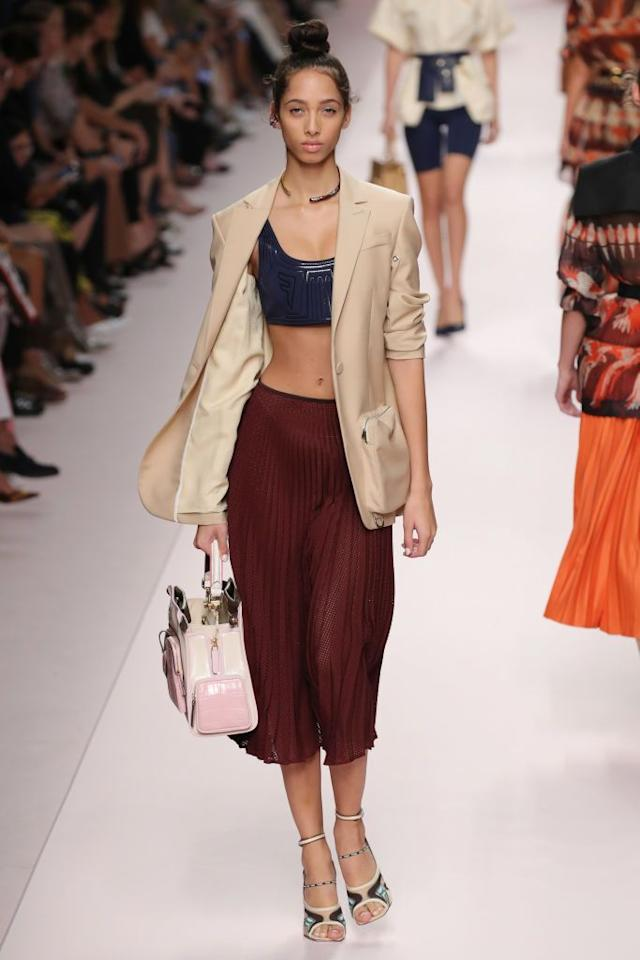 <p>This polished blazer and pleated skirt got a summery update, worn with a sporty cropped tank top.</p>