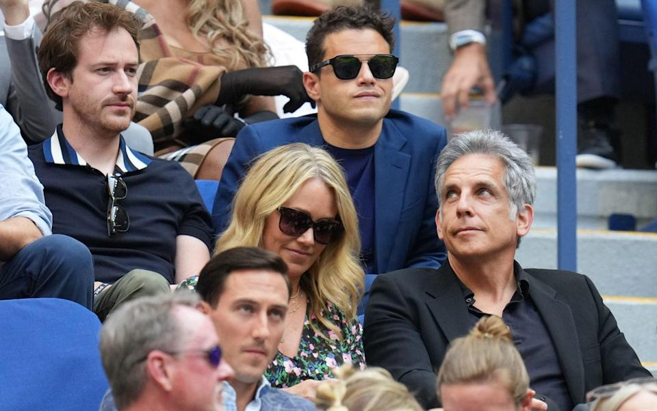 Ben Stiller and wife Christine Taylor watch the final, with Rami Malek behind them - USA TODAY
