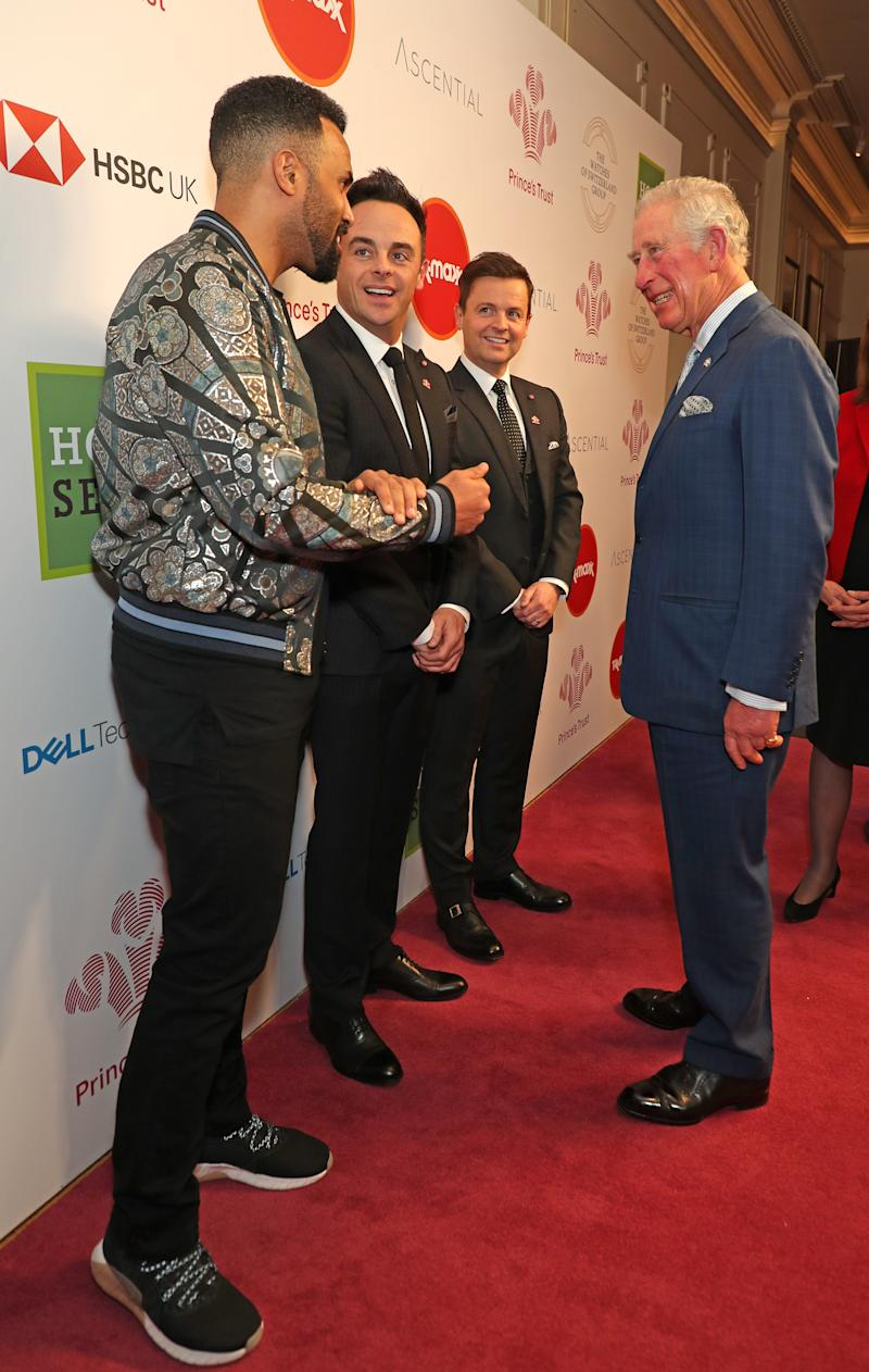 The Prince of Wales speaks with (left to right) singer Craig David and television presenters Ant McPartlin and Declan Donnelly as he arrives at the annual Prince's Trust Awards 2020 held at the London Palladium.