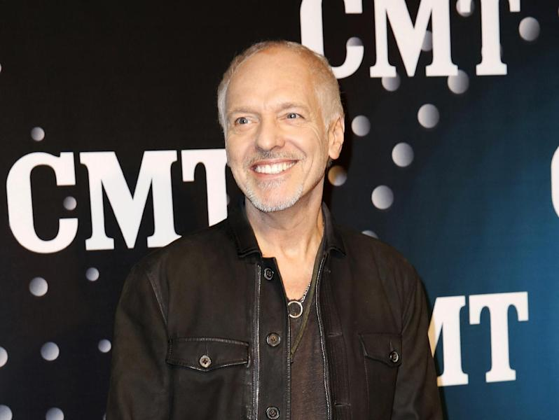 "FILE - This Dec. 3, 2013 file photo shows Peter Frampton posing on the red carpet at the CMT ""Artists of the Year at Bridgestone Arena in Nashville, Tenn. The Musicians Hall of Fame inducted 12 new members, Tuesday, Jan. 28, 2014, across the genres, including bluesman Buddy Guy, British rock guitarist Peter Frampton and pedal steel player and country singer Barbara Mandrell. (Photo by Donn Jones/Invision/AP, File)"