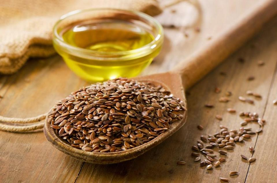 """Make your favorite smoothie healthier in seconds with the addition of some ground flaxseed. Without changing the flavor or consistency of your drink, flaxseed provides a healthy dose of fiber, which a 2015 study published in the <em>American Journal of Clinical Nutrition</em> revealed can <a href=""""https://www.ncbi.nlm.nih.gov/pmc/articles/PMC4588743/"""" rel=""""nofollow noopener"""" target=""""_blank"""" data-ylk=""""slk:reduce your risk of colorectal cancer"""" class=""""link rapid-noclick-resp"""">reduce your risk of colorectal cancer</a>."""