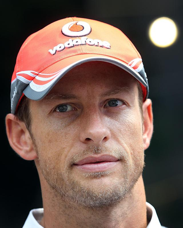 McLaren Mercedes driver Jenson Button of Britain smiles during a sponsor's event held on Wednesday, Sept. 18, 2013, ahead of the Formula One Singapore Grand Prix to be held Sunday in Singapore.(AP Photo/Wong Maye-E)