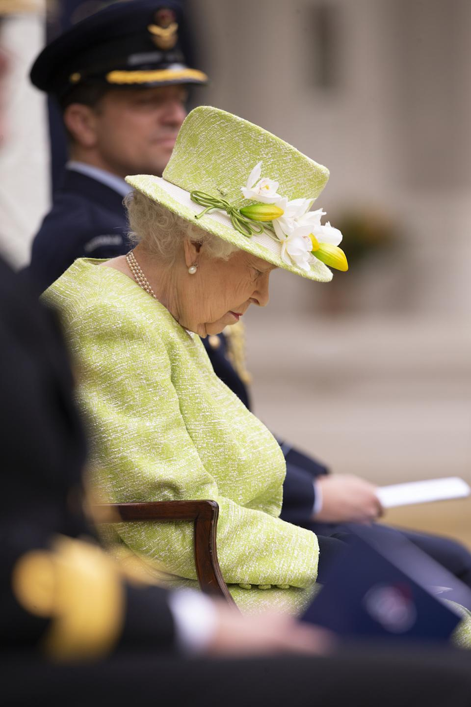 Queen Elizabeth II sits for a service to mark the Centenary of the Royal Australian Air Force at the CWGC Air Forces Memorial in Runnymede, Surrey. Picture date: Wednesday March 31, 2021.