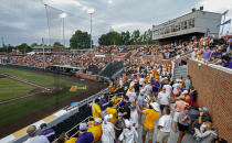 Fans exit the stadium after lightning was detected, causing a delay in an NCAA college baseball super regional game between Tennessee and LSU, Saturday, June 12, 2021, in Knoxville, Tenn. (AP Photo/Wade Payne)