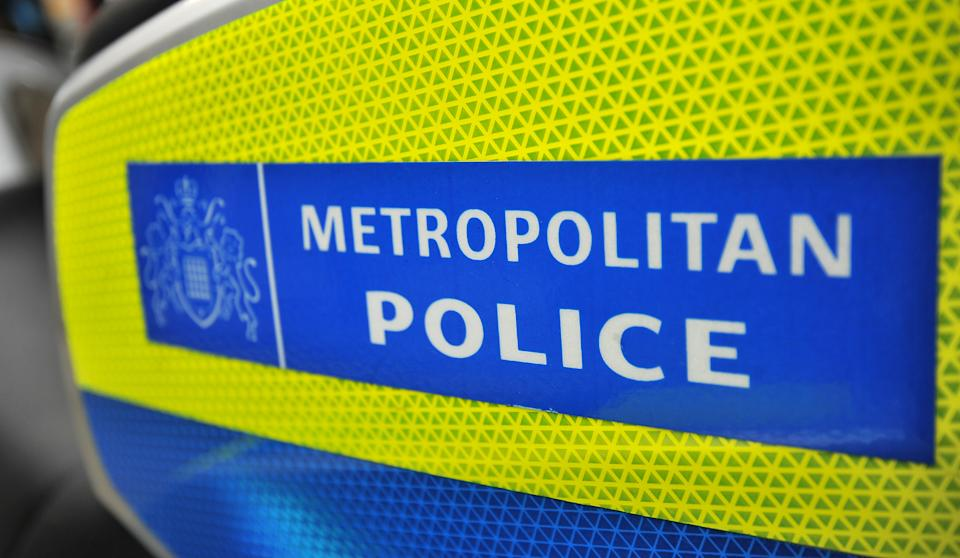 General view of a Metropolitan Police sign on the side of a BMW London Metropolitan police motorcycle