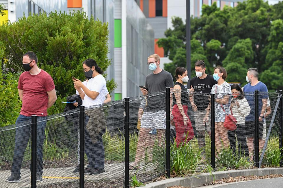Large numbers of people continue to head to testing clinics across Sydney. Source: Getty