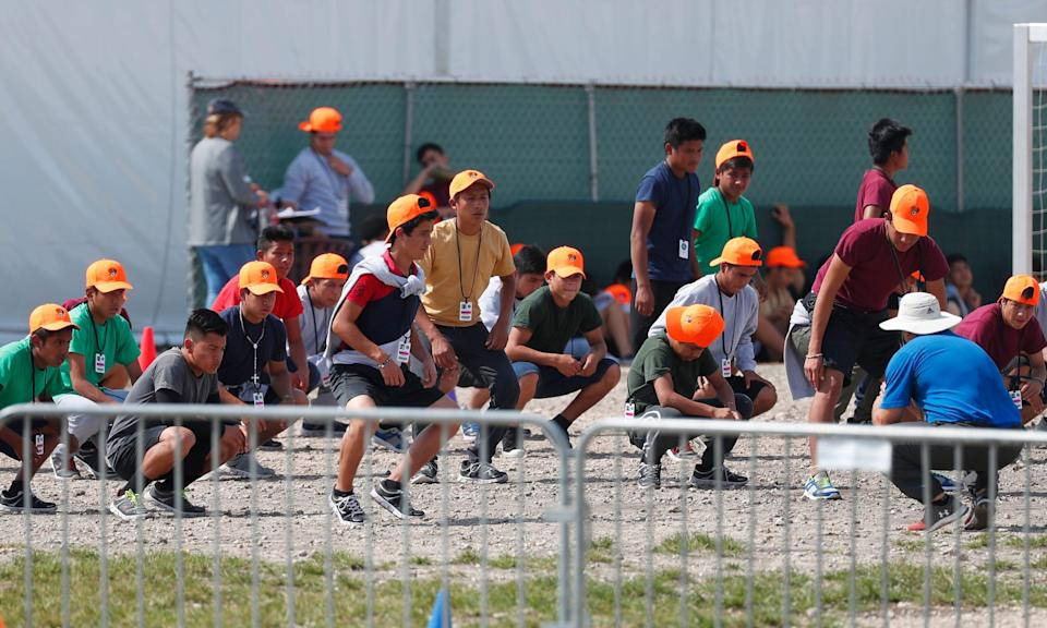 Migrant children exercise at a shelter in Homestead, Florida, on May 6, 2019.