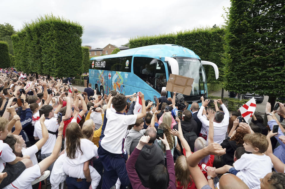England fans cheer off the official England Team bus as they leave the Grove Hotel, Hertfordshire, England, and head to Wembley Stadium for the Euro 2020 soccer championship final match between England and Italy Sunday July 11, 2021. (Jonathan Brady//PA via AP)