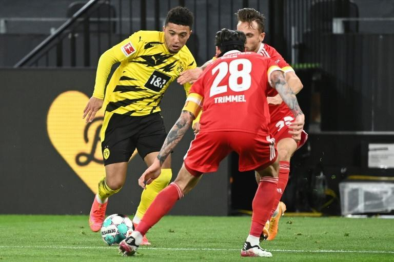 England winger Jadon Sancho (L) made his 100th Bundesliga appearance in Wednesday's win over Union Berlin