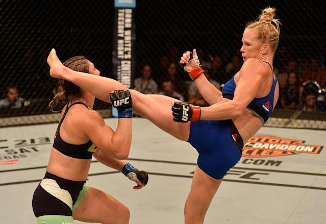 After three consecutive losses, Holly Holm (R) got back into the win column on June 17 by scoring a head-kick knockout of Bethe Correia in Singapore. (Getty Images)