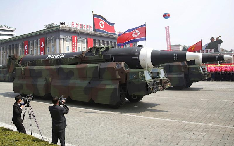 In this Saturday, April 15, 2017 photo, in what military experts say appears to be a North Korean KN-08 Intercontinental Ballistic Missile (ICMB) is paraded across Kim Il Sung Square during a military parade in Pyongyang, North Korea, to celebrate the 105th birth anniversary of Kim Il Sung, the country's late founder and grandfather of current ruler Kim Jong Un - Credit:  Wong Maye-E/AP