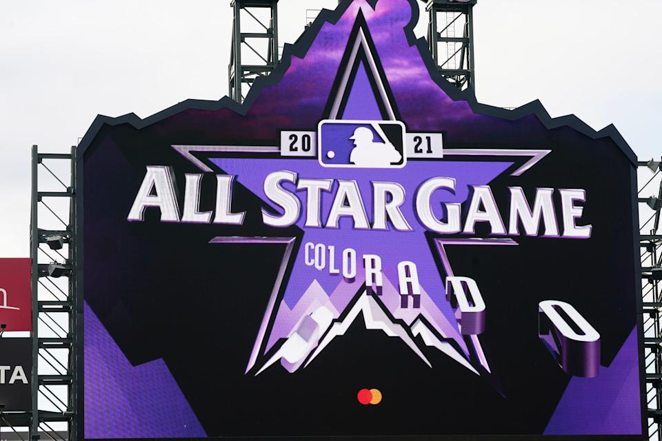 The logo for the 2021 Major League Baseball All-Star Game is revealed on the scoreboard before a baseball game between the Philadelphia Phillies and the Colorado Rockies, Friday, April 23, 2021, in Denver. (AP Photo/David Zalubowski)