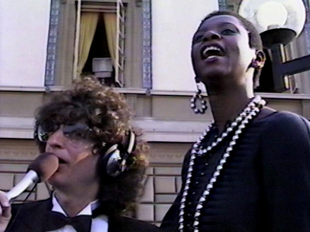 """Before he became an award winner himself, Howard Stern was still willing to work the red carpet and interview celebrities. Here he is at the Emmy Awards in 1987 with his lovely and talented on-air partner Robin Quivers. (""""Sidekick"""" doesn't seem like a good enough title for the beloved Robin.) <a href=""""http://bit.ly/yVrlv3"""" rel=""""nofollow"""">View the entire gallery at Snakkle.</a>"""