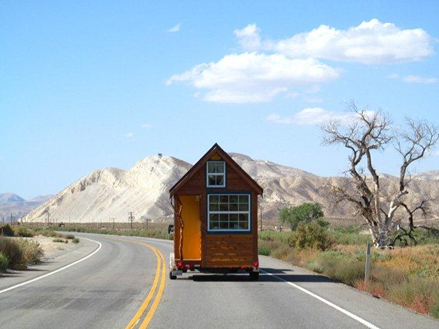 """The musician used savings to purchase a building kit from Tumbleweed Tiny House Company in 2011, figured out how to build it with some help from her stepfather in his Frazier Park driveway and drove it to a piece of open grassland in Half Moon Bay that she rents from a family ranch. Jenkins spent a total of $16,000 on the house itself, a figure that was kept low due to assistance from electrician, plumber and contractor friends. She's nicknamed it Little Yellow, and has documented her construction adventure and her time there on a blog called """"Littleyellowdoor."""""""