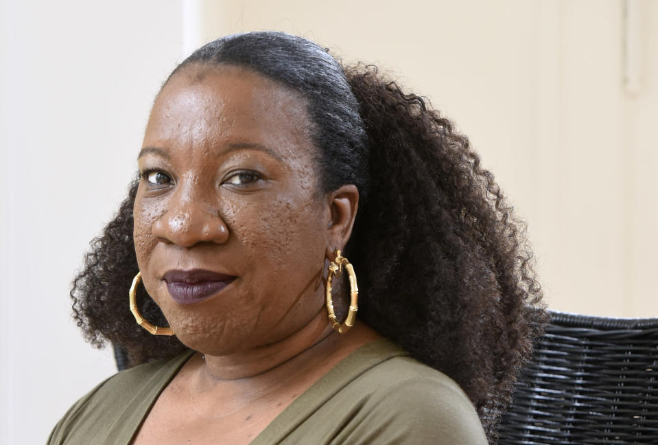 """FILE - Tarana Burke, founder and leader of the #MeToo movement, stands in her home in Baltimore on Oct. 13, 2020. Burke released her memoir, """"Unbound: My Story of Liberation and the Birth of the Me Too Movement"""" on Sept. 14, 2021. (AP Photo/Steve Ruark, File)"""