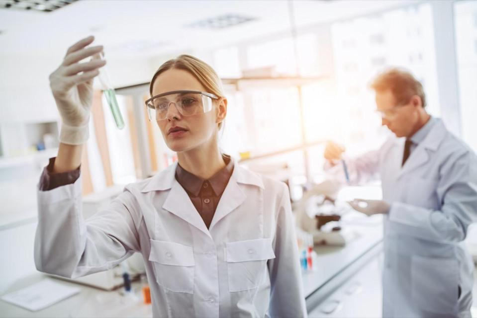 Scientist examining bacterial culture plate in a microbiology research laboratory
