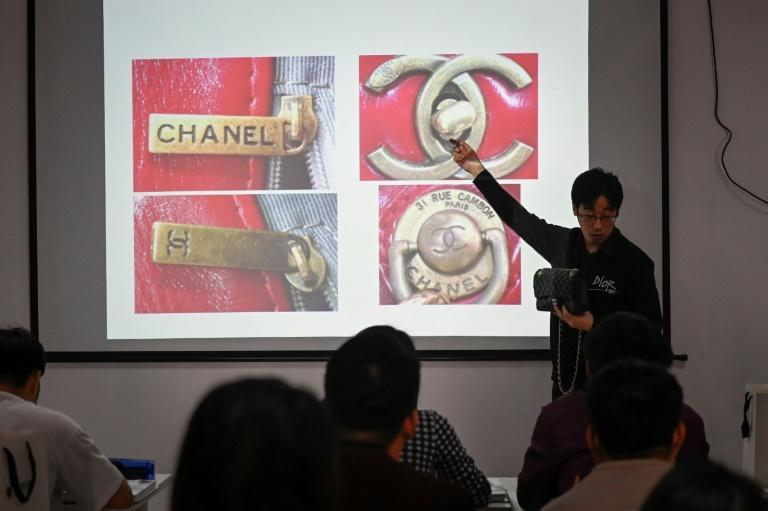 Zhang Chen, founder of the Extraordinary Luxuries Business School, teaching a class in Beijing