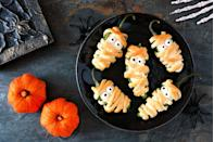 """<p>As you start gearing up for your Halloween festivities, <a href=""""https://www.womansday.com/food-recipes/food-drinks/g2497/halloween-party-food"""" rel=""""nofollow noopener"""" target=""""_blank"""" data-ylk=""""slk:planning a party menu"""" class=""""link rapid-noclick-resp"""">planning a party menu </a>is likely high on your list of priorities. And while you may think guests will be be fine with an array of <a href=""""https://www.womansday.com/food-recipes/food-drinks/g2586/halloween-desserts/"""" rel=""""nofollow noopener"""" target=""""_blank"""" data-ylk=""""slk:Halloween desserts"""" class=""""link rapid-noclick-resp"""">Halloween desserts</a> and drinks, you may want to balance the sweet stuff with some Halloween appetizers. Yes, your <a href=""""https://www.womansday.com/food-recipes/food-drinks/recipes/a51843/black-chocolate-cake/"""" rel=""""nofollow noopener"""" target=""""_blank"""" data-ylk=""""slk:witch cake"""" class=""""link rapid-noclick-resp"""">witch cake</a> and cookie haunted mansion may impress your guests, but your severed toes in a blanket (AKA pigs in a blanket) will truly<em> knock them dead</em>. </p><p>These Halloween finger foods and light bites will get everyone ready for the <a href=""""https://www.womansday.com/life/g28153252/halloween-games/"""" rel=""""nofollow noopener"""" target=""""_blank"""" data-ylk=""""slk:Halloween activities"""" class=""""link rapid-noclick-resp"""">Halloween activities</a> you have planned, whether you're throwing the biggest costume party of the year or gearing up for a long night of trick or treating. And don't worry if some of your guests have dietary restrictions. This list of Halloween appetizers includes some vegetarian options for those meat-free folks, like veggie """"fingers"""" or viles of dip, as well as big bites of traditional favorites, like the Jack-o-lantern ham and cheese sandwich bites. Whip up any one of these recipes for some delicious bites that will leave your guests screaming with delight. </p>"""