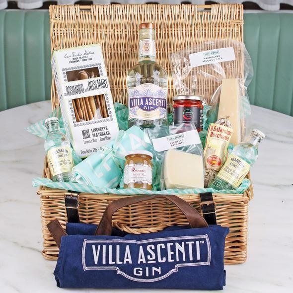"""<p><a class=""""link rapid-noclick-resp"""" href=""""https://shop.linastores.co.uk/collections/christmas-hampers/products/villa-ascenti-hamper"""" rel=""""nofollow noopener"""" target=""""_blank"""" data-ylk=""""slk:SHOP"""">SHOP</a></p><p>Italian deli Lina Stores has been a Soho institution for over seventy years, and they truly understand quality food and drink. That's why you can be rest assured that this collection of cheese, spreads, meats and gin will make everyone very, very happy indeed. Your gift-getter will also have a nice cooking apron to unroll, which may well get them in the mood to make you a sandwich with the aforementioned meats, cheeses and spreads. We're playing 3D chess here, people.</p>"""