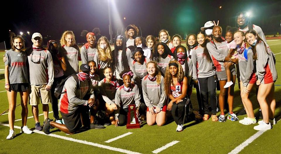 The district champion Cardinal Gibbons girls' track & field team.