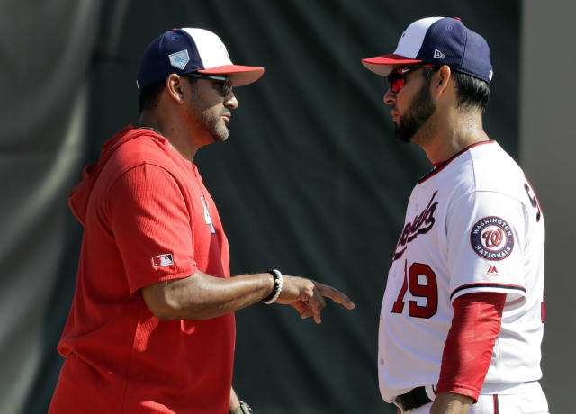FILE - In this Feb. 16, 2019, file photo, Washington Nationals manager Dave Martinez, left, talks with pitcher Anibal Sanchez during spring training baseball practice, in West Palm Beach, Fla. Dave Martinez heads into Year 2 on the job knowing that his team needs to play better, and win more, than it did in his first season. He began the process of trying to improve by meeting individually with players late last season. (AP Photo/Jeff Roberson, File)