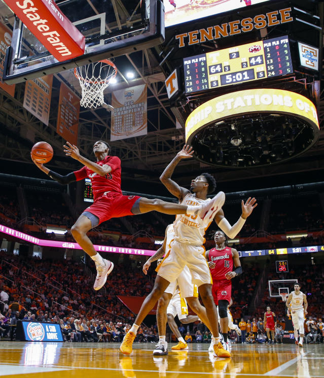 Jacksonville State guard Elias Harden (13) shoots past Tennessee guard Jordan Bowden (23) during the second half of an NCAA college basketball game Saturday, Dec. 21, 2019, in Knoxville, Tenn. Tennessee won 75-53. (AP Photo/Wade Payne)