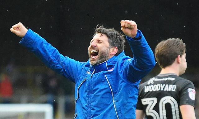 Danny Cowley celebrates Lincoln City's 1-0 win at Carlisle United on Easter Monday, with midfielder Alex Woodyard behind him.
