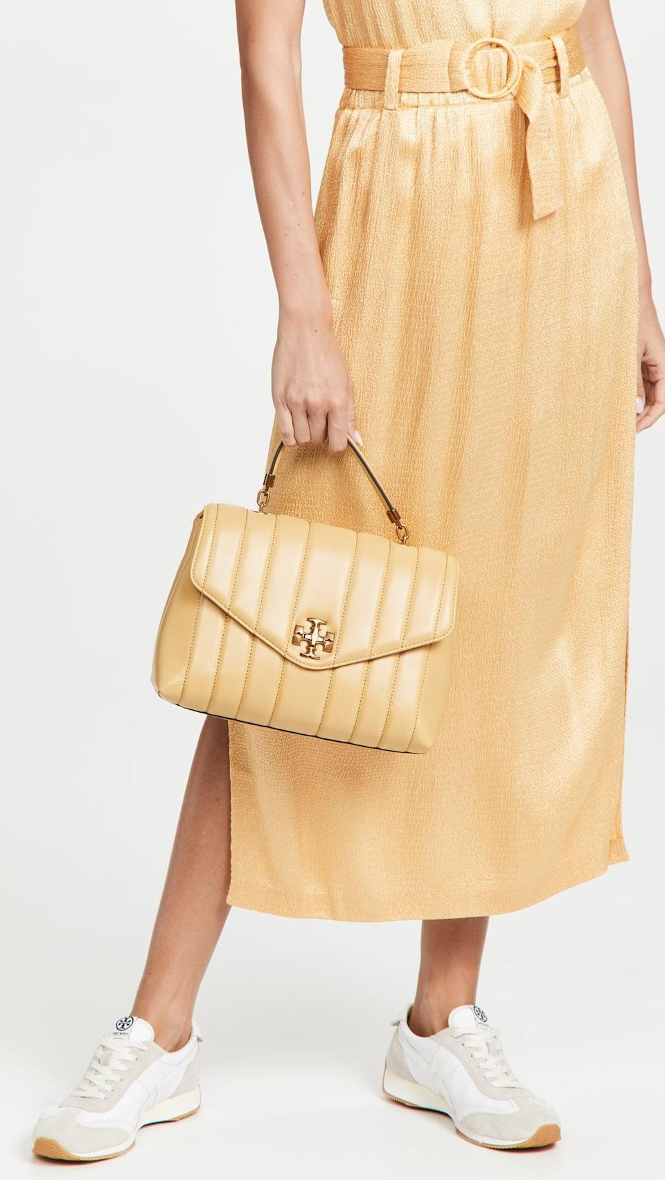 <p>Tory Burch is always a good choice, and the <span> Kire Top Handle Satchel</span> ($698) is too cute. The light yellow shade is the perfect pop of color.</p>