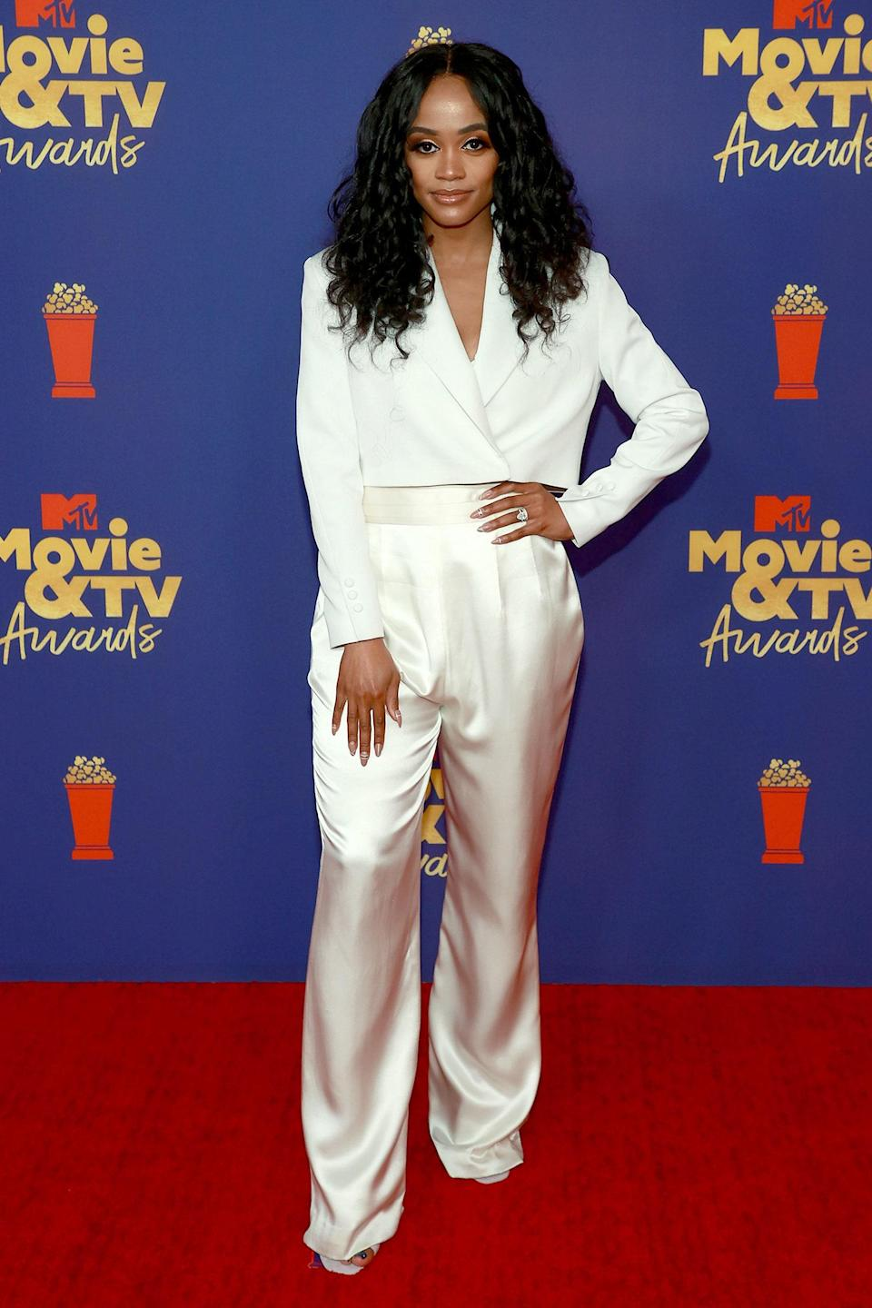 Former <em>Bachelorette</em> contestant Rachel Lindsay showed up in an elegant take on the pantsuit. She rocked a boxy cropped blazer with floor-length silk pants. She paired her classy monochrome look with a diamond ring and tousled curls.