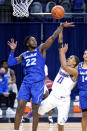 DePaul guard Charlie Moore, right, shoots over Seton Hall guard Myles Cale during the second half of an NCAA college basketball game in Chicago, Saturday, Jan. 9, 2021. (AP Photo/Nam Y. Huh)