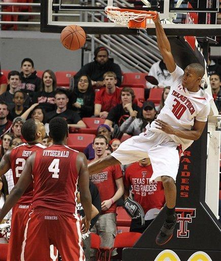 Texas Tech's Jaye Crockett dunks ahead of Oklahoma's Andrew Fitzgerald (4) and Romero Osby, left, during their NCAA college basketball game in Lubbock, Texas, Saturday, Feb. 11, 2012. (AP Photo/Lubbock Avalanche-Journal, Zach Long) ALL LOCAL TV OUT